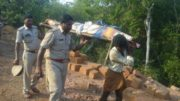 Karnataka cops carry a dead body down a hill as locals deny refusing help